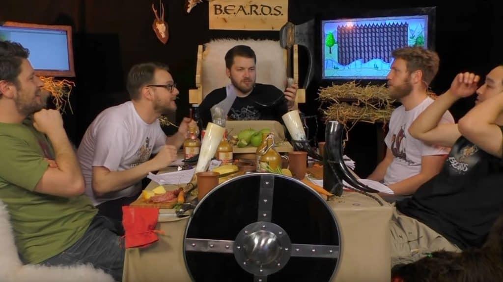 fünf Männer spielen ein Pen-&-Paper-Rollenspiel